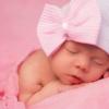 Newborn muts wit met roze strik