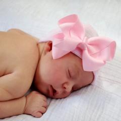 Newborn muts met roze strik van lint roze gestreept extra warm