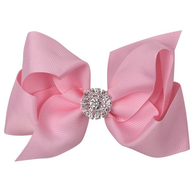 Roze strik haarclip met strass steentjes